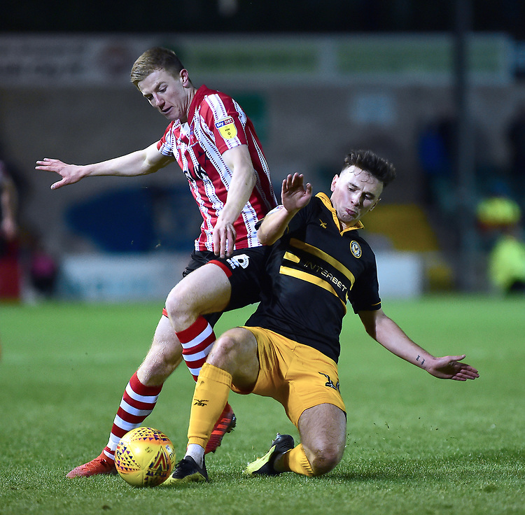 Lincoln City's Scott Wharton vies for possession with Newport County's Mark Harris<br /> <br /> Photographer Andrew Vaughan/CameraSport<br /> <br /> The EFL Sky Bet League Two - Lincoln City v Newport County - Saturday 22nd December 201 - Sincil Bank - Lincoln<br /> <br /> World Copyright © 2018 CameraSport. All rights reserved. 43 Linden Ave. Countesthorpe. Leicester. England. LE8 5PG - Tel: +44 (0) 116 277 4147 - admin@camerasport.com - www.camerasport.com