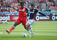 02 April 2011: Chivas USA forward Alejandro Moreno #15 and Toronto FC defender Nana Attakora #3 in action during an MLS game between Chivas USA and the Toronto FC at BMO Field in Toronto, Ontario Canada..The game ended in a 1-1 draw.