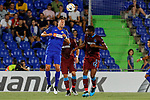 Jaime Mata of Getafe CF and Majid Hosseini (L) and Obi Mikel (R) of Trabzonspor during UEFA Europa League match between Getafe CF and Trabzonspor at Coliseum Alfonso Perez in Getafe, Spain. September 19, 2019. (ALTERPHOTOS/A. Perez Meca)