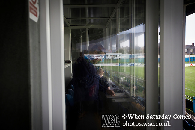 Port Talbot Town 3 Caerau Ely 0, 06/02/2016. Genquip Stadium, Welsh Cup fourth round. The stadium announcer working as Port Talbot Town host Caerau Ely in a Welsh Cup fourth round tie at the Genquip Stadium, formerly known as Victoria Road. Formed by exiled Scots in 1901 as Port Talbot Athletic, they competed in local and regional football before being promoted to the League of Wales  in 2000 and changing their name to the current version a year later. Town won this tie 3-0 against their opponents from the Welsh League, one level below the welsh Premier League where Port Talbot competed, watched by a crowd of 113. Photo by Colin McPherson.