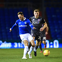 Oldham Athletic's Dan Gardner under pressure from  Lincoln City's Harry Anderson.  Dan Gardner, then went over injured<br /> <br /> Photographer Andrew Vaughan/CameraSport<br /> <br /> The EFL Sky Bet League Two - Oldham Athletic v Lincoln City - Tuesday 27th November 2018 - Boundary Park - Oldham<br /> <br /> World Copyright © 2018 CameraSport. All rights reserved. 43 Linden Ave. Countesthorpe. Leicester. England. LE8 5PG - Tel: +44 (0) 116 277 4147 - admin@camerasport.com - www.camerasport.com