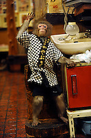 Fuku-chan, 6, a Japanese monkey waiter, waves in an Izakaya bar in north of Tokyo, Japan. The six year old monkey looks after the guests hot towels by taking them from the steamer oven and delivering them to all guests. The bar is extremely popular amongst people from all over Japan who come to see the monkey waiters.