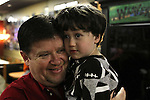 Juddy Weaver, 3rd generation owner of Weaver's Hot Dogs, holds his son Tyson Weaver, the future owner. Photo by Alex Holt