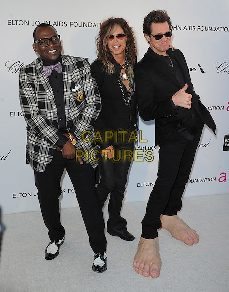 Randy Jackson, Steven Tyler (of Aerosmith) & Jim Carrey.The 21st Annual Elton John AIDS Foundation Academy Awards Viewing Party held at The City of West Hollywood Park in West Hollywood, California, USA..February 24th, 2013.oscars full length grey gray check suit jacket leather trousers scarf necklace hand thumb up sunglasses shades funny giant large oversized feet make-up prosthetics .CAP/DVS.©DVS/Capital Pictures.
