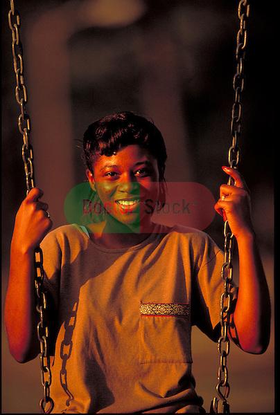 smiling girl on swings