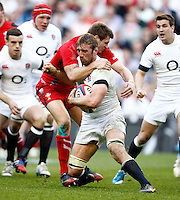 Photo: Richard Lane/Richard Lane Photography. England v Wales. RBS Six Nations. 09/03/2014. England's Chris Robshaw is tackled by Wales' Dan Bigger.