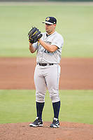 Charleston RiverDogs relief pitcher Omar Luis (20) looks to his catcher for the sign against the Kannapolis Intimidators at CMC-NorthEast Stadium on June 28, 2014 in Kannapolis, North Carolina.  The Intimidators defeated the RiverDogs 4-3. (Brian Westerholt/Four Seam Images)