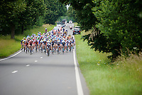 peloton storming down a hill chasing the breakaway group now 1 minute ahead<br /> <br /> Ster ZLM Tour 2014