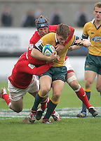 Australian centre Rowan Kellam on the attack during the Division A 3rd/4th place clash at Ravenhill, Belfast. Result Australia 25 Wales 21.