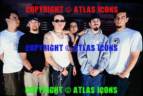 MIAMI FL - APRIL 27 : Mike Shinoda, Joe Hahn, Chester Bennington, Dave Farrell, Brad Delson and Rob Bourdon of Linkin Park pose for a portrait at Bayfront Park Ampitheatre on April 27, 2001 in Miami, Florida. : Credit Larry Marano (C) 2001