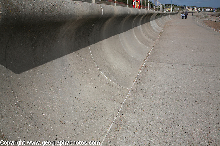 Curved shape of wave return wall. Coastal defences, Felixstowe, Suffolk, England. The curved surface shape is designed to return the incoming water back to sea rather than simply forming a solid rigid barrier.