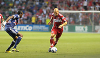 Chicago midfielder Freddie Ljungberg (8) looks to get by New York midfielder Macoumba Kandji (10).  The Chicago Fire tied the New York Red Bulls 0-0 at Toyota Park in Bridgeview, IL on August 8, 2010