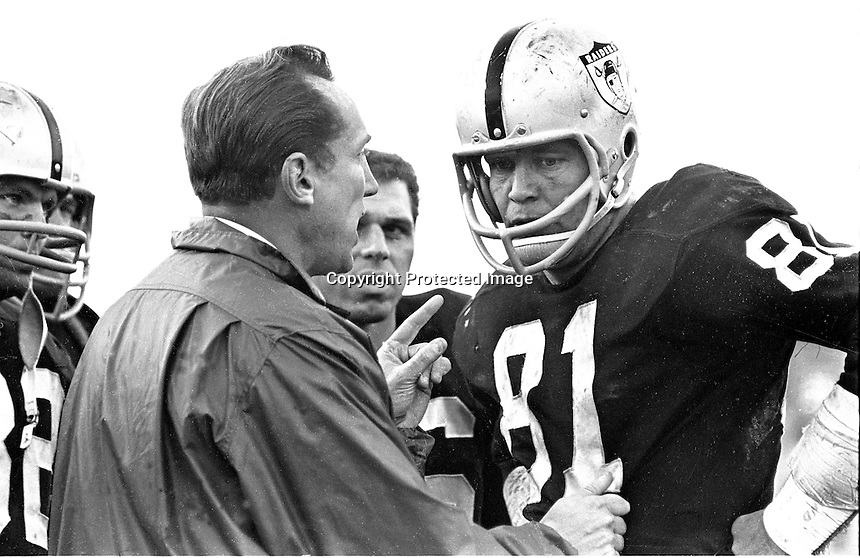 Oakland Raider coach Al Davis gives instructions to reciever Clancy Osborne #81 during game at Frank Youell Field in Oakland (1963 photo by Ron Riesterer)