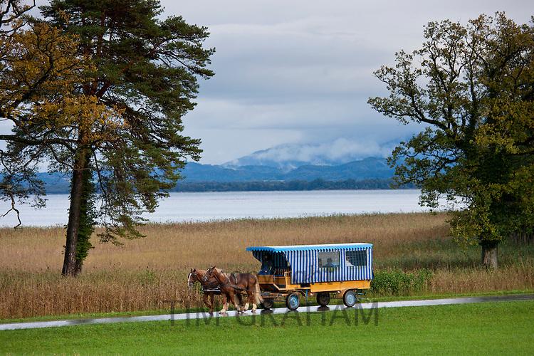 Tourist bus at Konigschloss Herrenchiemsee castle on Herren Insel island in Chiemsee Lake, Baden-Wurttenberg, Bavaria, Germany