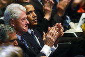 New York, NY - September 9, 2009 -- United States President Barack Obama (R) sits with former U.S. President Bill Clinton (C) at a tribute to the late television journalist Walter Cronkite on September 9, 2009 at Lincoln Center in New York City. Numerous dignitaries attended the morning memorial service for the former CBS anchorman who died in July. Obama is returning to Washington later today to deliver a major prime-time address to a joint session of Congress on health care.  .Credit: Spencer Platt / Pool via CNP