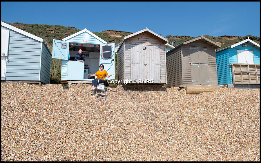 BNPS.co.uk (01202 558833)<br /> Pic: PhilYeomans/BNPS<br /> <br /> Tracey Meade and her father - living on the edge in May last year....<br /> <br /> A group of beach hut owners have been evicted from a coastal beauty spot after a local council refused to replenish a shingle bank that washed away.<br /> <br /> Around 20 owners were last week given their marching orders from Hordle Cliff in Hants after coastal erosion left a 12ft drop outside the timber chalets.<br /> <br /> Some rent-payers were given as little seven days notice to vacate the pebble beach, condemning at estimated £1.1m worth of beach huts to destruction.