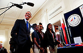 United States President Barack Obama listens to Stephanie Bullock  (R) who is part of a team from the US Virgin Islands that design rockets for the Team America Rocketry Challenge, during the 2015 White House Science Fair, a celebration of students winners of STEM (Science, technology, engineering and math) competitions from across the country at the White House, in Washington, DC on March 23, 2015.<br /> Credit: Aude Guerrucci / Pool via CNP