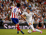 Atletico Madrid's Portuguese player Thiago vies with  Real Madrid's Welsh forward Gareth Bale during the Spanish league football match Real Madrid CF vs Club Atletico de Madrid at the Santiago Bernabeu stadium in Madrid on September 13, 2014.  DP / Photocall3000