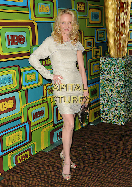 ANNE HECHE.The HBO's Post Golden Globes Party held at The Beverly Hilton Hotel in Beverly Hills, California, USA..January 16th, 2011.full length beige dress one sleeve hand on hip silver clutch bag       .CAP/RKE/DVS.©DVS/RockinExposures/Capital Pictures.