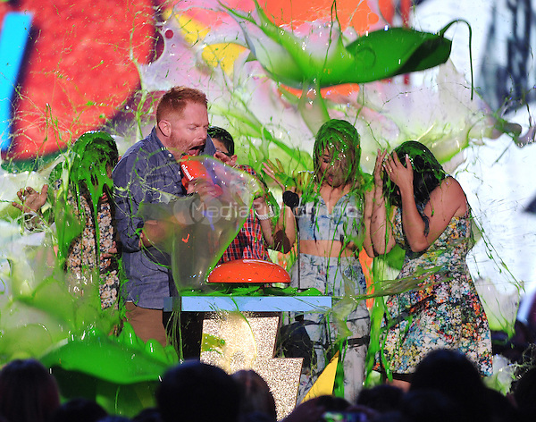 INGLEWOOD, CA - MARCH 28: (L-R) Actors Nolan Gould, Jesse Tyler Ferguson, Rico Rodriguez, Sarah Hyland and Ariel Winter get slimed on the 28th Annual Nickelodeon Kids Choice Awards at the Forum on March 28, 2015 in Inglewood, California. Credit: PGFM/MediaPunch