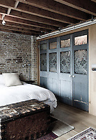 Original doors from the days when the building was a factory have been recycled as wardrobe doors in the bedroom