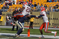 Syracuse running back Antwon Bailey (29) does a backward hurdle overtop of Pitt defensive back K'Waun Williams (2) to score on a 26-yard touchdown reception as Syracuse wide receiver Van Chew (82) looks on. The Pittsburgh Panthers beat the Syracuse Orange 33-20 at Heinz Field in Pittsburgh, Pennsylvania on December 3, 2011