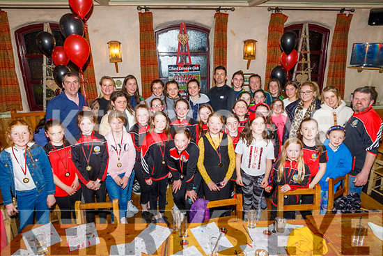 Aidan O'Mahoney (Guest of Honour) stands with the medal winners at the Cillard Camogie Medal presentation in Kate Browns in Ardfert on Friday night.