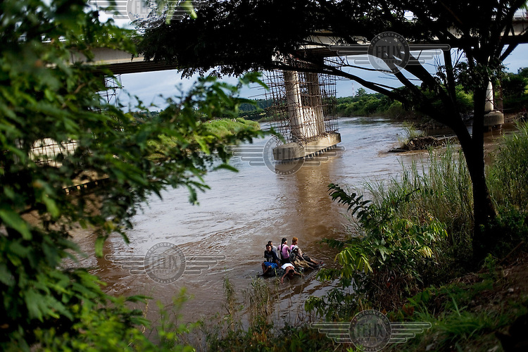 Karen people illegally cross into Thailand at the Mae Tao river that is the border between Burma and Thailand.