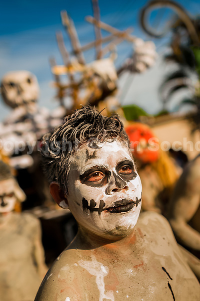 A Salvadoran boy, painted an ashen grey, performs an indigenous mythology character in the La Calabiuza parade at the Day of the Dead festivity in Tonacatepeque, El Salvador, 1 November 2016. The festival, known as La Calabiuza since the 90s of the last century, joins Salvador's pre-Hispanic heritage and the mythological figures (La Sihuanaba, El Cipitío, La Llorona etc.) collected from the whole Central American region, together with the catholic All Saints Day holiday and its tradition of honoring the dead relatives. Children and youths only, dressed up in scary costumes and carrying painted carts, march from the local cemetery to the downtown plaza where the party culminates with music, dance, drinking and eating pumpkin (Ayote) with honey.
