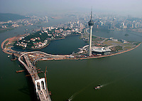 A view of Macau with the Macau Tower on the right and a section of the soon to be completed 'Third Bridge' on the left, Wednesday, 13 October 2004. The 'Third Bridge will link the island of Taipa directly to the Zhuhai Special Economic Zone on the Chinese mainland. Macau is upgrading its infrastructure in anticipation of a massive tourism boom that has already begun. The completion of several large scale US-led casino projects looms as close as the end of 2006.
