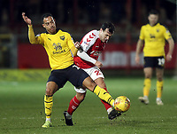 Fleetwood Town's Ross Wallace is tackled by Oxford United's Jordan Graham<br /> <br /> Photographer Rich Linley/CameraSport<br /> <br /> The EFL Sky Bet League One - Fleetwood Town v Oxford United - Saturday 12th January 2019 - Highbury Stadium - Fleetwood<br /> <br /> World Copyright &copy; 2019 CameraSport. All rights reserved. 43 Linden Ave. Countesthorpe. Leicester. England. LE8 5PG - Tel: +44 (0) 116 277 4147 - admin@camerasport.com - www.camerasport.com