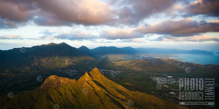 At sunrise, the morning shadow of the peak of Olomana stretches for miles until it hits the Ko'olau Mountains on Windward O'ahu.