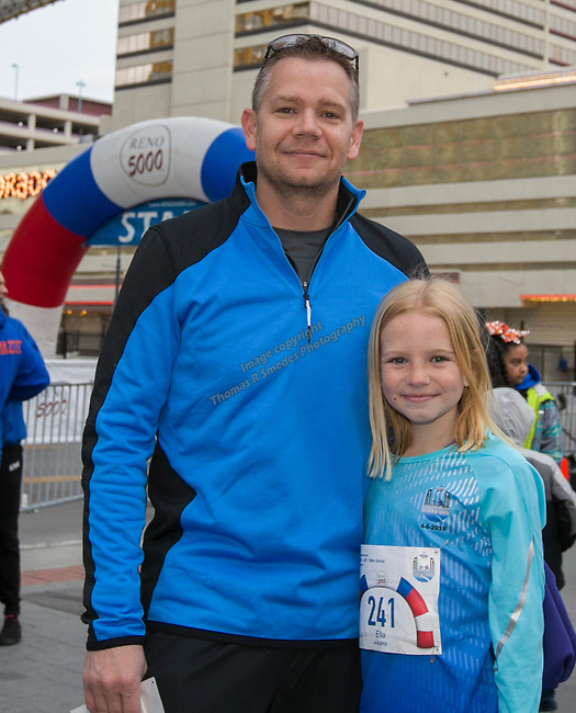 Matt and Ella Freeman during the 6th Annual Reno 5000 Downtown River Run on Saturday, April 6, 2019.