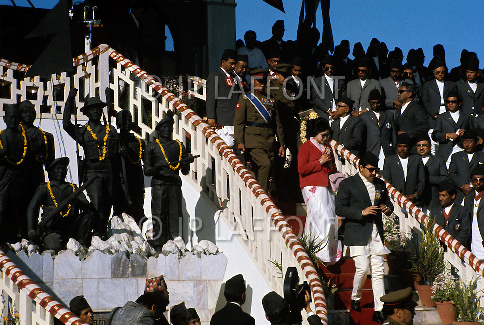 February 24th, 1975. Kathmandu. Nepal. The Coronation of King Birendra and Queen Aishwarya of Nepal, on the chosen day. At 8:37 a.m., the precise moment selected by court astrologers more than a year before, the royal priest placed the huge jewel-encrusted crown on the King's head and a diamond tiara atop Queen Aishwarya's. They were both massacred by their son Dipendra  on 1 June 2001. The King and the Queen arriving to the ceremony.