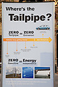 Poster promoting Nissan Leaf Electric car, the text reads: 'Where is the Tailpipe?'. Nissan Leaf Zero Emission Tour promotional event for the Nissan Leaf electric car that is scheduled to be released in Fall 2010. Car specs from Nissan: 5 person capacity, 90 MPH top speed, lithium-ion battery, 100 mile average range per charge. Santana Row, San Jose, California, USA, 12/5/09