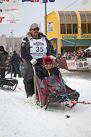 Mike Williams  Sr. and team leave the ceremonial start line at 4th Avenue and D street in downtown Anchorage during the 2013 Iditarod race. Photo by Jim R. Kohl/IditarodPhotos.com