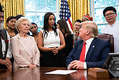 United States President Donald J. Trump welcomes survivors of religious persecution to the Oval Office at the White House in Washington, D.C. on Wednesday, July 17, 2019. <br /> Credit: Kevin Dietsch / Pool via CNP