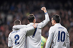 James Rodriguez of Real Madrid (right) celebrates with teammates Daniel Carvajal Ramos (left) and Cristiano Ronaldo (raising fist) during the match Real Madrid vs Napoli, part of the 2016-17 UEFA Champions League Round of 16 at the Santiago Bernabeu Stadium on 15 February 2017 in Madrid, Spain. Photo by Diego Gonzalez Souto / Power Sport Images