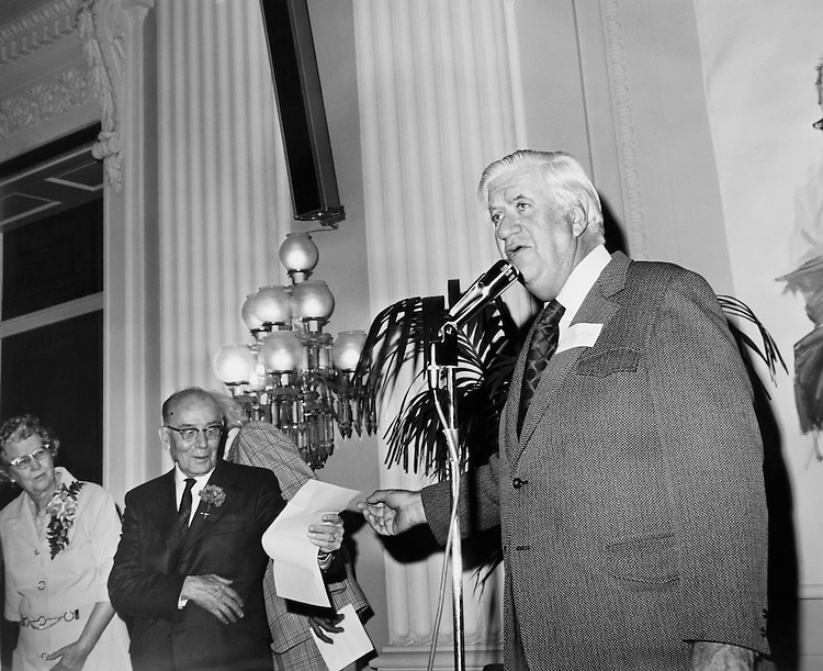 """Speaker of the House, Rep. Thomas Phillip """"Tip"""" O'Neill, House Majority Leader talking on microphone. (Photo by CQ Roll Call)"""