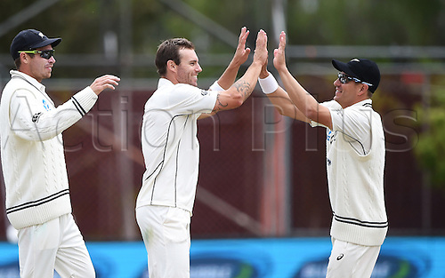 14.12.2015. Dunedin, New Zealand.  Tim Southee, Doug Bracewell and Neil Wagner celebrate winning the test match on day 5 of the 1st cricket test match between New Zealand Black Caps and Sri Lanka at University Oval, Dunedin, New Zealand. Monday 14 December 2015.