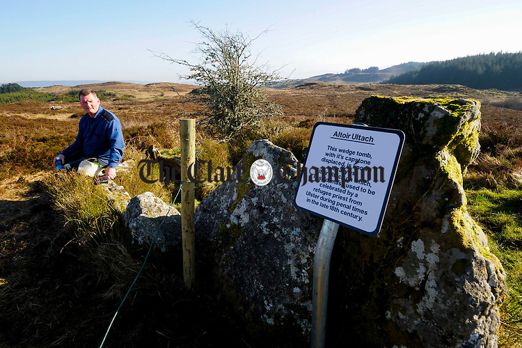 Councillor Pat Hayes rests at the Altoir Ultach wedge tomb/mass rock which has been renovated by the Feakle Rural Sociual Scheme on top of Ballycroum mountain in Feakle. Photograph by John Kelly.
