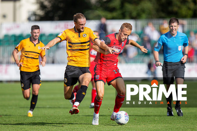 Fraser Franks of Newport County and Charles Vernam of Grimsby Town during the Sky Bet League 2 match between Newport County and Grimsby Town at Rodney Parade, Newport, Wales on August 25th 2018. Photo by Mark Hawkins.