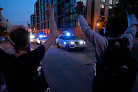Protestors keep their hands up as police approach to disperse the gathering in Washington, D.C., U.S., on Monday, June 1, 2020, following the death of an unarmed black man at the hands of Minnesota police on May 25, 2020.  More than 200 active duty military police were deployed to Washington D.C. following three days of protests.  Credit: Stefani Reynolds / CNP/AdMedia