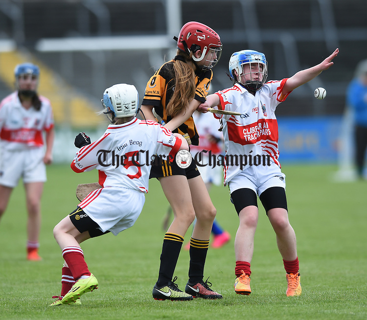 Stella Quinlivan of Ballyea in action against Caoimhe Cahill and Orla Kenny of Inch at the Clare Primary schools Hurling and Camogie finals in Cusack Park. Photograph by John Kelly.