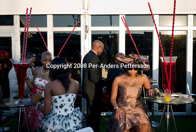 DURBAN, SOUTH AFRICA - JULY 5: Black up-market people attend the annual Durban July horse race on July 5, 2008, in Durban, South Africa. It?s the biggest social event of the winter season and people from all over the country come to dress up and party. Many of South Africa?s big companies host lavish parties and receptions for VIP clients. The country has a growing number of black middle class and wealthy people, enjoying the spoils of democracy in the country. (Photo by: Per-Anders Pettersson/Getty Images)..