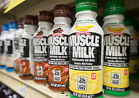 "Bottles of the Muscle Milk brand protein drink are seen on a grocery shelf in New York on Wednesday, July 2, 2014. Hormel Foods, the maker of Spam, has purchased CytoSport, Muscle Milk's owner, for $450 million. Hormel is expanding beyond its stable of meat products and recent surveys have shown that consumers are buying ""portable"" meals that they can eat or drink on the go. (© Richard B. Levine)"