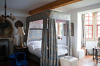 The bed hangings in The Primavera Room are made from beautifully patterned blue and taupe silk