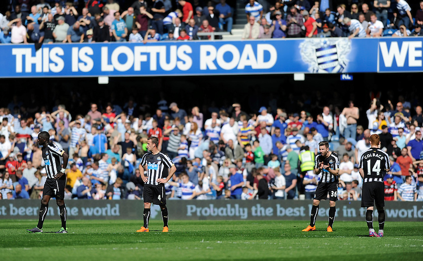 Newcastle United players dejected after going behind 2-1 to Queens Park Rangers<br /> <br /> Photographer Ashley Western/CameraSport<br /> <br /> Football - Barclays Premiership - Queens Park Rangers v Newcastle United - Saturday 16th May 2015 - Loftus Road - London<br /> <br /> &copy; CameraSport - 43 Linden Ave. Countesthorpe. Leicester. England. LE8 5PG - Tel: +44 (0) 116 277 4147 - admin@camerasport.com - www.camerasport.com