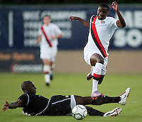 Manchester City midfielder Jeremy Helan jumps over Portland Timbers defender Mamadou Danso during a match at Merlo Field in Portland Oregon on July 17, 2010.