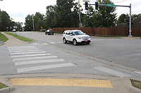 Traffic moves along Wednesday, July 22, 2020, on Zion Road near the intersection of Vantage Drive in Fayetteville. The City Council on Tuesday approved construction contracts to do improvement work on the street from Vantage Drive to Crossover Road, a project that was originally included in the city's 2006 bond improvement program. Check out nwaonline.com/200726Daily/ and nwadg.com/photos for a photo gallery.<br /> (NWA Democrat-Gazette/David Gottschalk)
